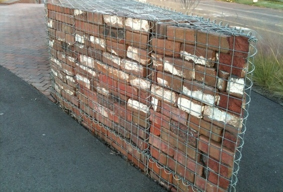 ... Old Bricks In A Curved Gabion Wall