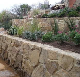 rock retaining wall set in cement - Rock Wall Design